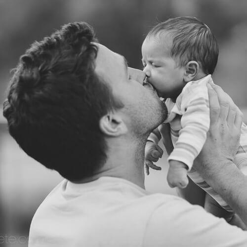 Dad kiss baby