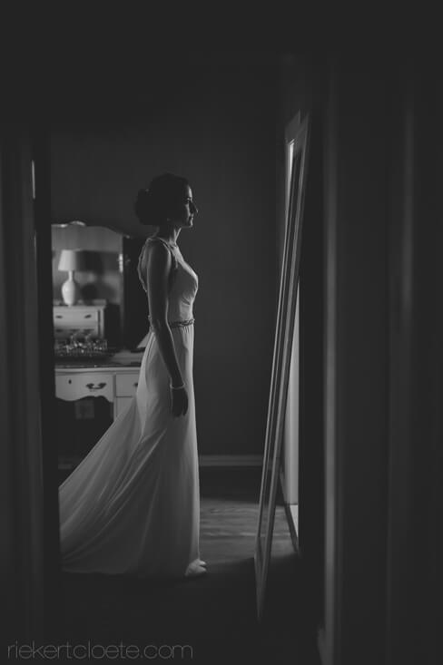 Bride in front of mirror