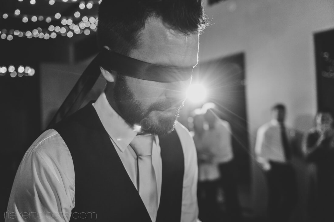 Groom blindfolded