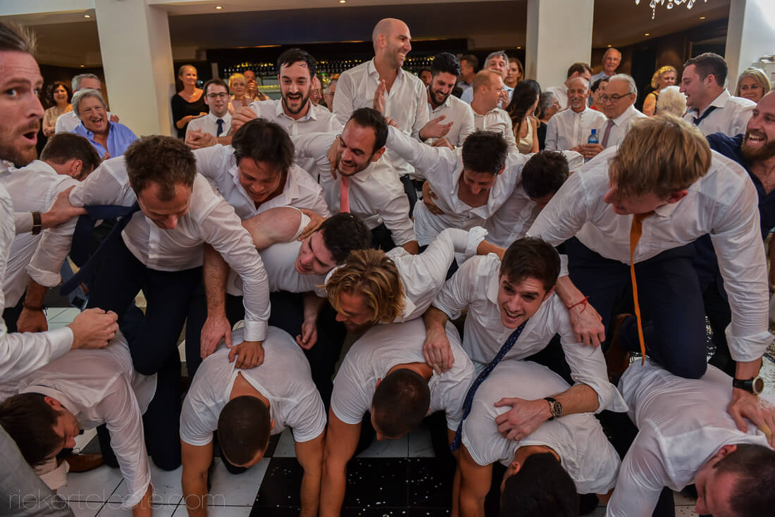 Guys at Jewish wedding stacked