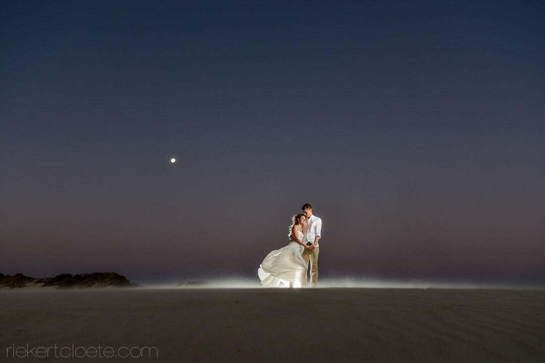 Couple on beach at night