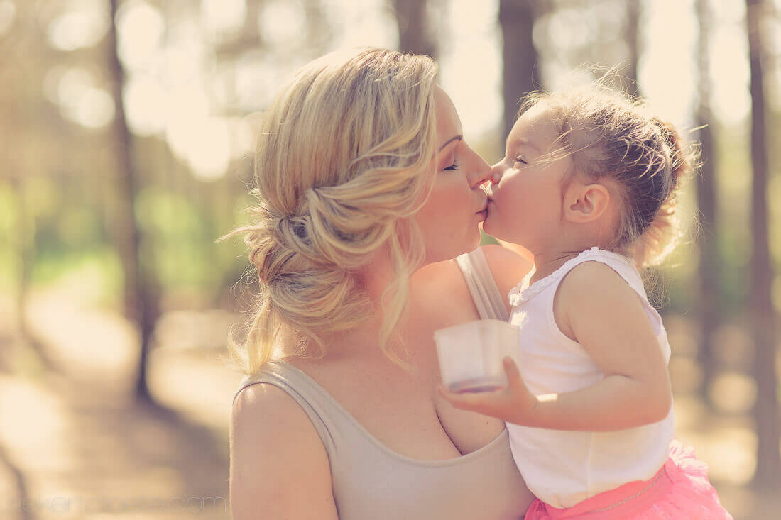 Mom Kissing daughter