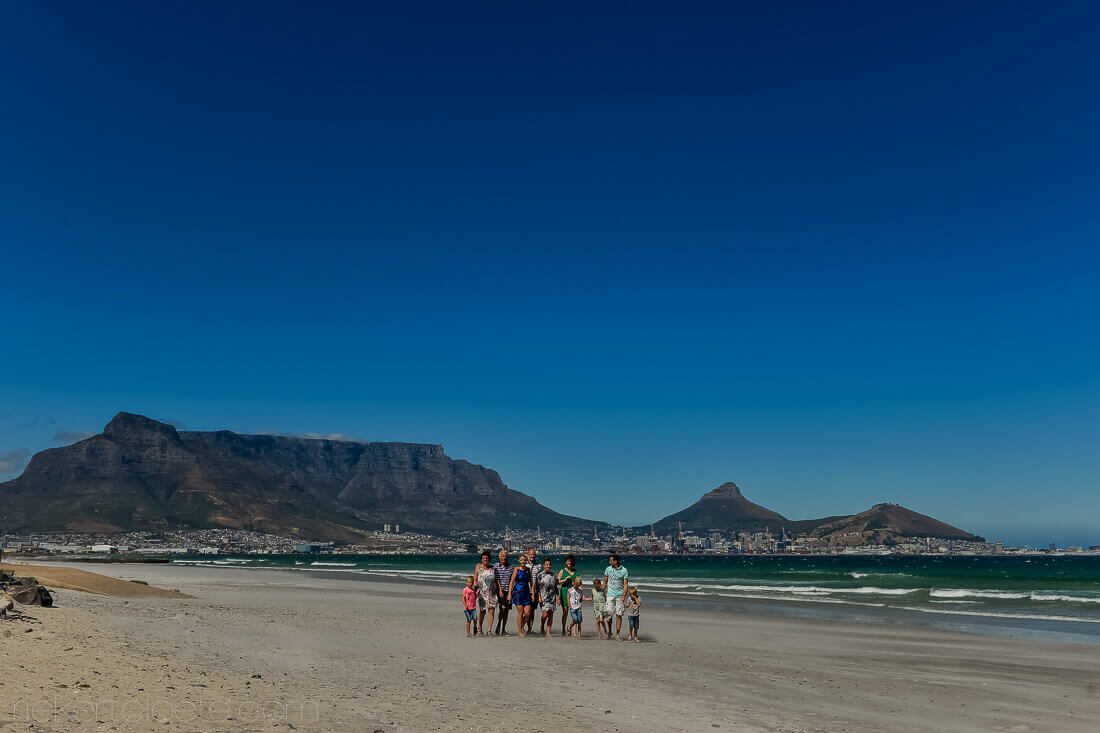 Family on beach with Table mountain