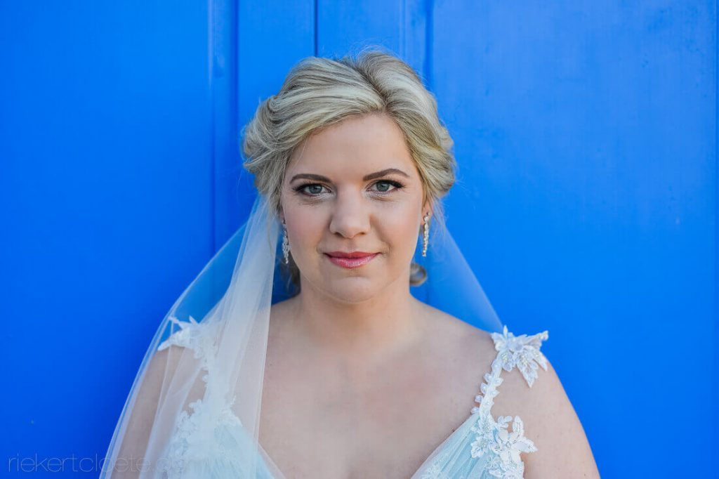 Blue door behind Bride