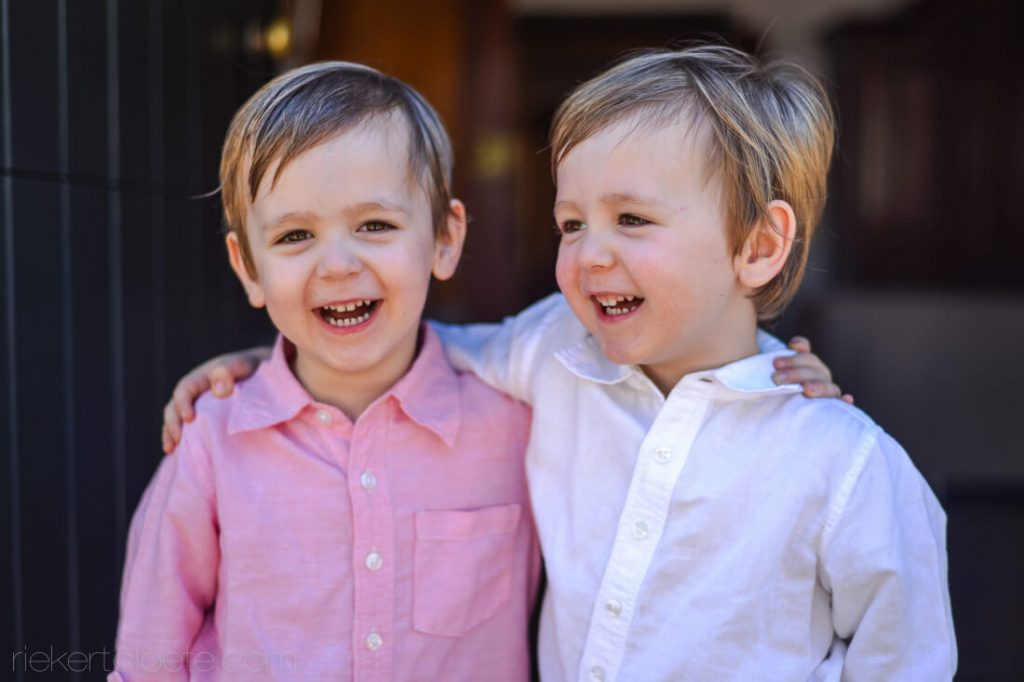 two boys laughing together