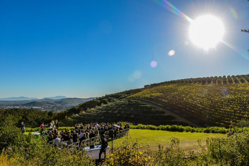 Ceremony with the sun and vineyards in the background