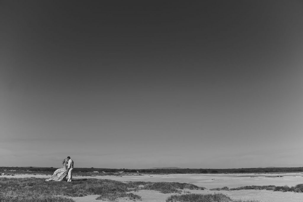 Weddind couple on grassy beach