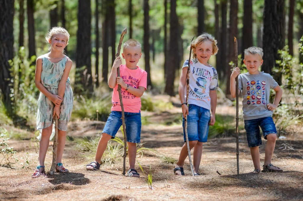 4 children holding sticks