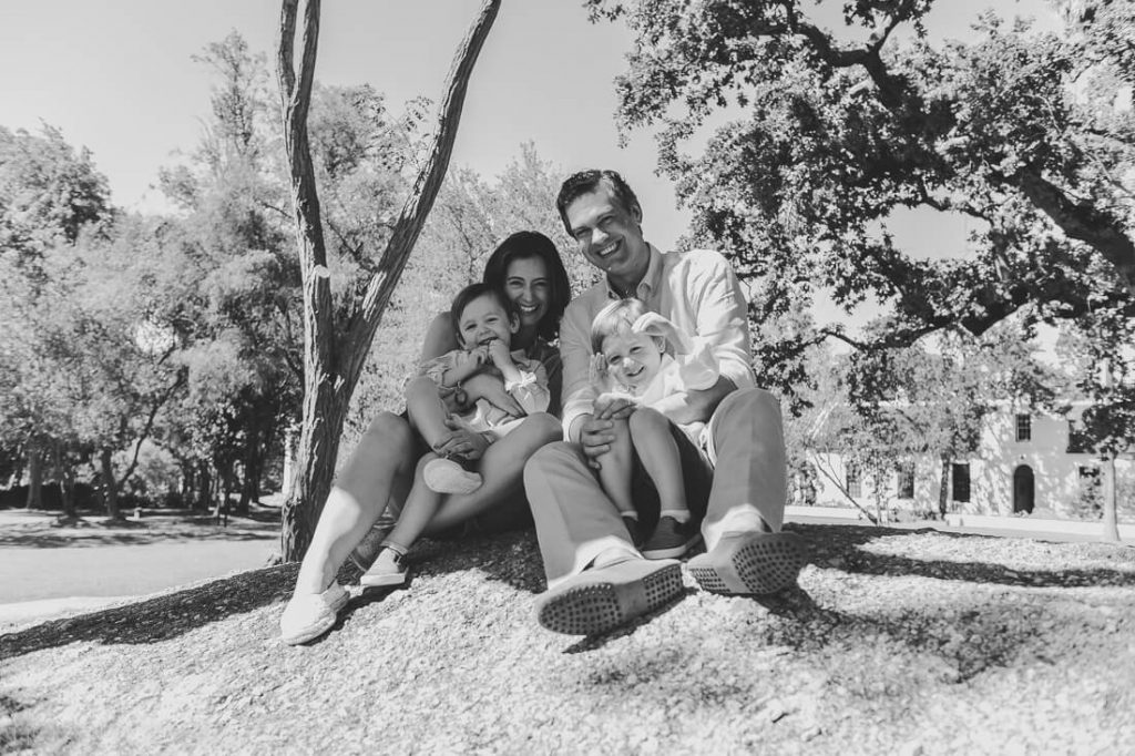Family posing on a boulder