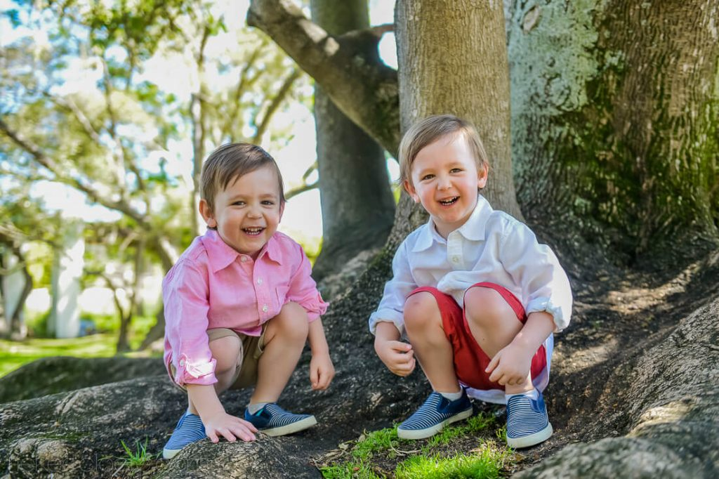 two boys smiling at camera