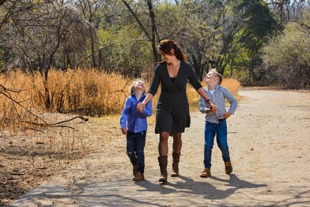 Mom and boys walking