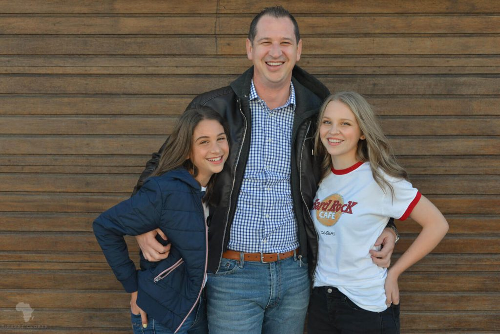 Dad and Daughters standing