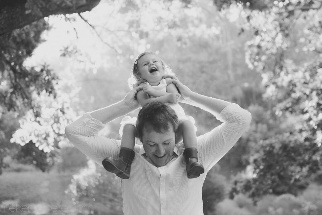 Girl on DAd neck