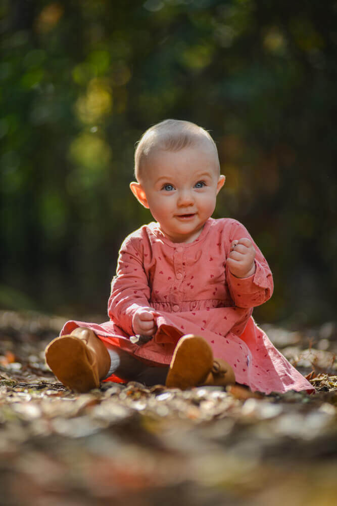 Baby with peach dress